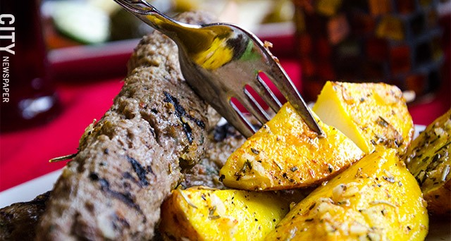 Adana - seasoned beef and lamb grilled on skewers - with roasted potatoes.