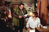 NEW LINE CINEMA - An argument for living alone? Ethan Suplee and Ashton Kutcher in The Butterfly Effect.