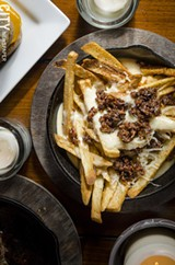 "At Nox: ""It's a Trap"" is made of seasoned fries topped with melted cheese and sausage - PHOTO BY MARK CHAMBERLIN"