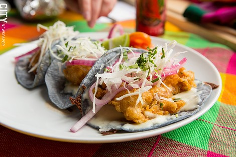Beer-battered tilapia tacos from Rio Tomatlan. - PHOTO BY JOHN SCHLIA