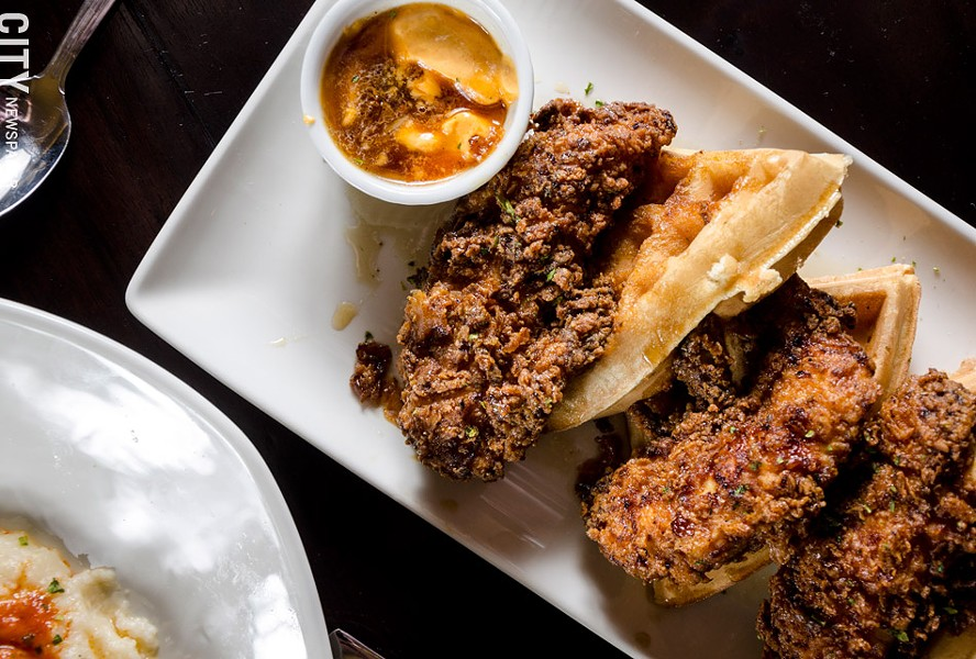 Belgian waffles with maple syrup, fried chicken, and smoked chili butter. - PHOTO BY MARK CHAMBERLIN