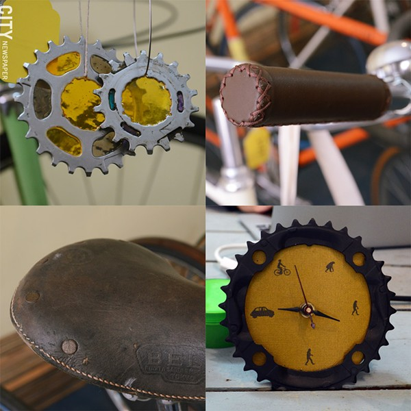 Bike art, materials, and equipment details inside Yellow Haus Bicycles. - PHOTO BY LARISSA COE