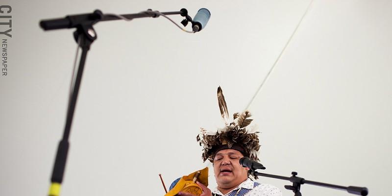 [ Slideshow ] Ganandogan Dance & Music Festival Blane Tallchief of the Seneca nation performs a traditional Native American song under the Performance Tent at the Ganondagan festival in Victor, NY. PHOTO BY MATT BURKHARTT