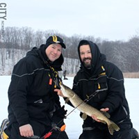 Ice Fishing Brothers Jeff and Tim Thomas (left to right) with a northern pike caught at the Victory Baptist Church Sportsmen Ice Fishing Derby on Hundred Acre Pond at Mendon Ponds Park. PHOTO BY KATHY LALUK