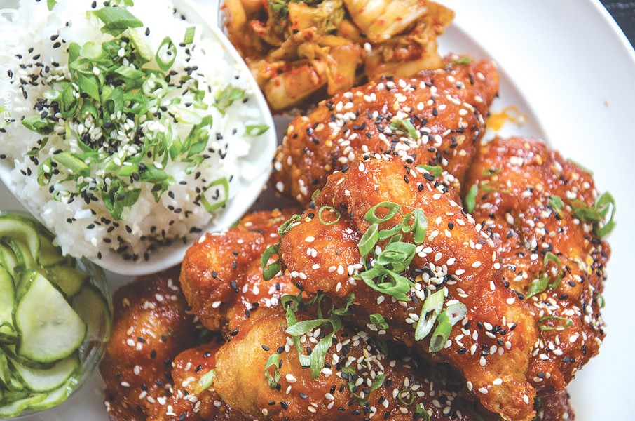 Butapub's Korean Fried Chicken served with gochujang, kim chi, pickles, and rice. - PHOTO BY MARK CHAMBERLIN
