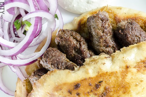 Cevapi made with spiced ground beef from Mamma Lucia. - PHOTO BY MARK CHAMBERLIN