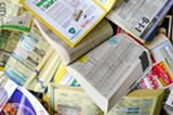 PHOTO BY MARK CHAMBERLIN - Changing how phone books are delivered could mean few piles of unwanted or unused directories.
