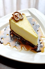 Cheesecake with a pretzel crust and caramel sauce from Tournedos Steakhouse. - PHOTO BY MATT DETURCK