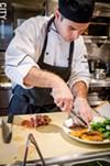 Chef Joel Valenti plating the Amore Steak.