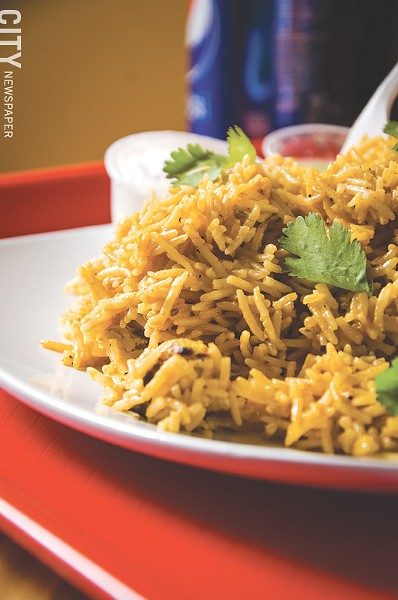 Chicken Biryani with rice cooked with heavy cream, cilantro, nuts, and raisins. - PHOTO BY MARK CHAMBERLIN