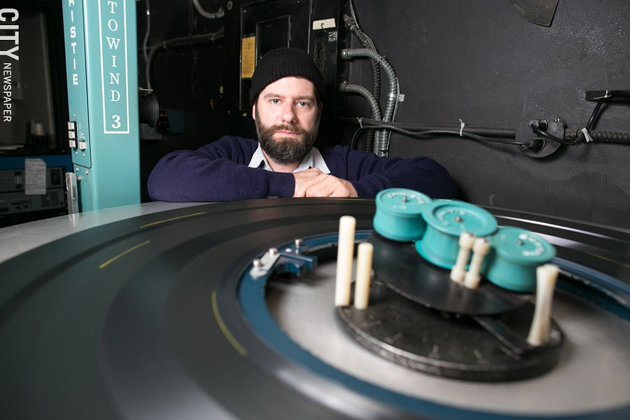 "Chris Hogan-Roy is the lead projectionist at The Little. ""There are still a lot of theaters running 35mm,"" he says. ""That's a beautiful format that should never be ruined. Digital will be great for a lot of reasons, but I don't think digital will ever match film."" - PHOTO BY MIKE HANLON"