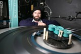 """Chris Hogan-Roy is the lead projectionist at The Little. """"There are still a lot of theaters running 35mm,"""" he says. """"That's a beautiful format that should never be ruined. Digital will be great for a lot of reasons, but I don't think digital will ever match film."""" - PHOTO BY MIKE HANLON"""