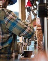 PHOTO BY MARK CHAMBERLIN - Co-owner Tony Colón preparing a latte