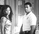"MGM PICTURES - Crossing the racial divide: Sanaa Lathan and Denzel Washington in ""Out of Time."""