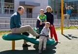 JOHN SCHLIA - Daniel and Laura Delehanty play with their children at World of Inquiry School 58.