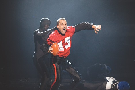 "Darren Stevenson (in red) and other members of PUSH Physical Theatre perform a Super Bowl-inspired routine on truTV's ""Fake Off."" - PHOTO BY ANNETTE BROWN"