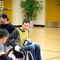 Quad Rugby Dave King rushes the ball toward the goal line. PHOTO BY MARK CHAMBERLIN