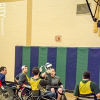 Quad Rugby Dave Sprout (facing camera) mid-catch during a Wreckers practice. PHOTO BY MARK CHAMBERLIN