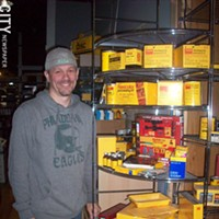 Local Memorabilia Eric Kunsman with a case of Kodak. PHOTO BY KATHERINE STATHIS