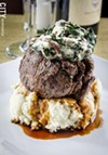 Filet mignon served over roasted garlic mash and topped with smoked gouda creamed swiss chard.