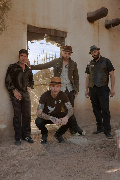 Flogging Molly bassist Nathen Maxwell (pictured crouching) started a side project, The Original Bunny Gang, to explore his personal musical interest and a totally different sound. - PHOTO COURTESY DONEZ