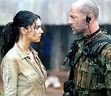 """For - God and cleavage: Monica Bellucci and Bruce Willis in """"Tears of the Sun."""""""