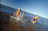 FILE PHOTO - Frolicking at the source: kids at play in Lake Ontario, part of the Great Lake basin.