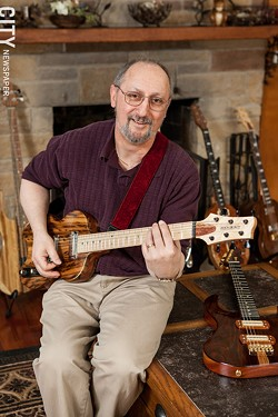 Greg Bogoshian with one of his guitars - PHOTO BY JOHN SCHLIA