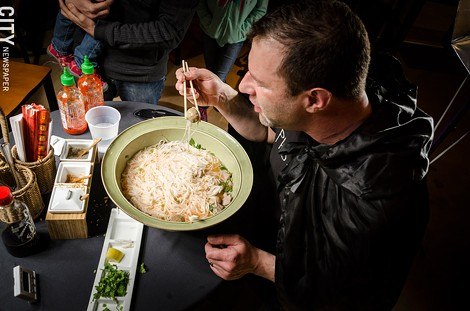 Greg Davis attempts to eat a seven-pound bowl of Pho at The Soup Spoon in Victor. - PHOTO BY MARK CHAMBERLIN