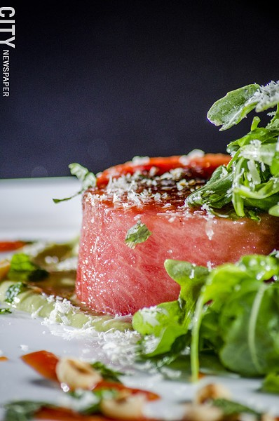 Grilled watermelon salad with arugula, feta cheese, hazelnuts, avocado and cucumber vinaigrette from Avvino. - PHOTO BY MARK CHAMBERLIN