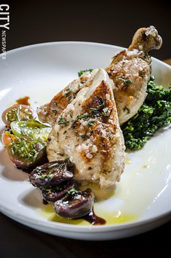 Half roasted chicken stuffed with foie gras and truffles and served with braised greens and tomatoes, from Avvino. - PHOTO BY MARK CHAMBERLIN