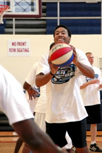 Hopeful JabaraMcKinstry - passes during tryouts for the RazorSharks. - CLARKE COND
