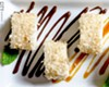 "Ice-cream ""sushi"" (vanilla ice cream roll covered in toasted coconut)."