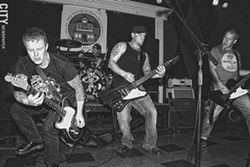 In addition to his prolific illustration work, Doug Mac (pictured, far right) is the bassist for local band Rock 'n' Roll Social Club. - PHOTO BY FRANK DE BLASE