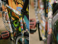 Jarred Foster pasted some of his favorite comic-book characters over the frame of one of his custom-built bikes. - PHOTO BY LARISSA COE