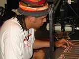 PHOTO BY JENNIFER WEISS - Jason Cuthbert in the WRUR studio, recording his show Wide Awake