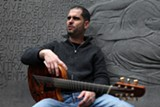 PHOTO BY GREG AIELLO - Jazz musician Charlie Hunter plays a custom-made seven-string instrument that fuses four guitar strings with three bass-octave strings; he plays both sets simultaneously.
