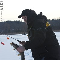 Ice Fishing Jeff Thomas at Mendon Ponds Park. PHOTO BY KATHY LALUK