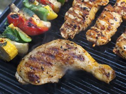 Jerk chicken and grilled vegetables. - FILE PHOTO