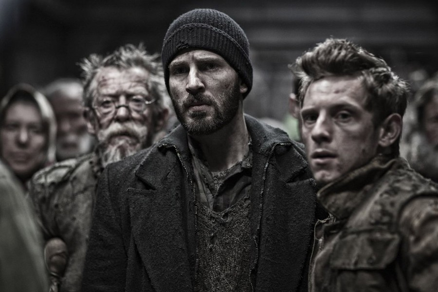 "John Hurt, Chris Evans, and Jamie Bell in ""Snowpiercer."" - PHOTO COURTESY THE WEINSTEIN COMPANY"