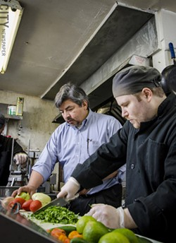 Jose Abarca and Joel Allatt in the kitchen at Itacate. - PHOTO BY MARK CHAMBERLIN