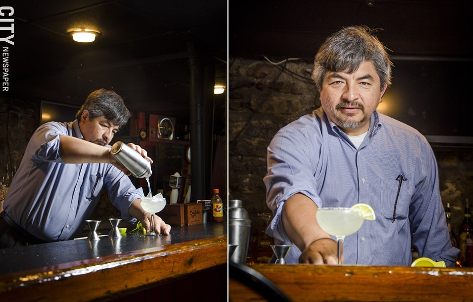 Jose Abarca pours a margarita with fresh lime juice  at Itacate in Penfield. Jose and his wife, both natives of Mexico, are making a point to use traditional family recipes for authentic Mexican meals. - PHOTO BY MARK CHAMBERLIN