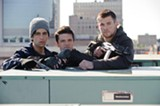 "Josh Peck, Josh Hutcherson, and Chris Hemsworth in the remake of ""Red Dawn."" PHOTO COURTESY OPEN ROAD FILMS"