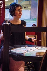 Katie Jo Suddaby with her sand mandala. - PHOTO BY MARK CHAMBERLIN