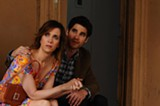 "PHOTO COURTESY MAVEN PICTURES - Kristen Wiig and Darren Criss in ""Girl Most Likely."""