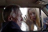 UNITED ARTISTS FILMS - Little comfort from the church: the fleeing priest (Philip Baker Hall) and the scared homeowner (Melissa George) in The Amityville Horror.