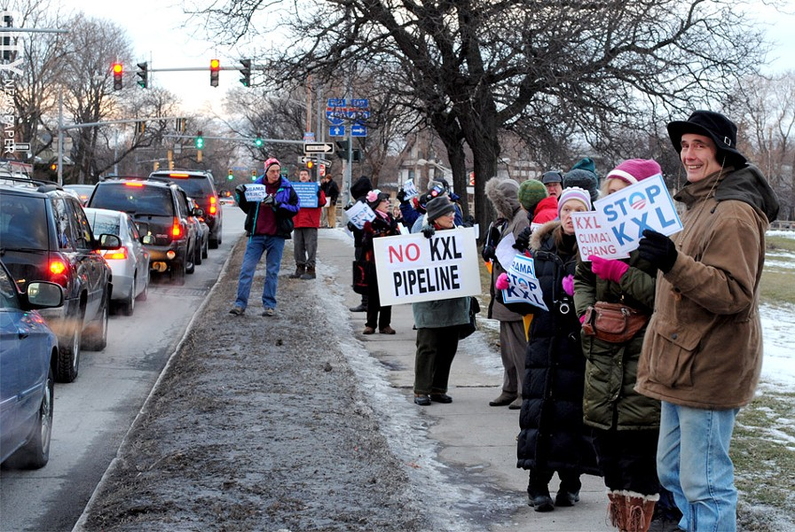Local residents lined Culver Road to protest the Keystone XL pipeline proposal. - PHOTO BY JEREMY MOULE