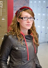 Marci Saunders-Arnett is more than $15,000 in debt after attending two community colleges. - PHOTO BY MARK CHAMBERLIN