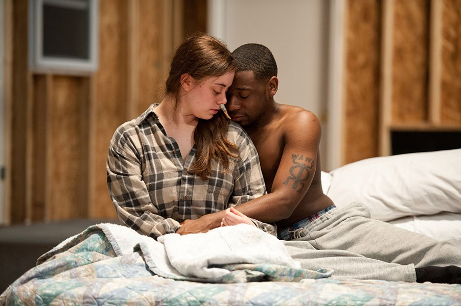 """Margaret (freshman Halle Burns) and Matthew (junior Shaquill McCullers) in the University of Rochester Todd Theatre's production of """"The Rochester Plays."""" PHOTO BY J. ADAM FENSTER / UNIVERSITY OF ROCHESTER"""