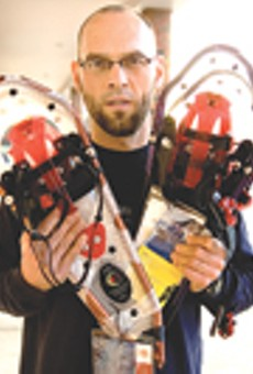 Medved's Mort Nace shows off some modern snowshoes; the Rochester area is home to several annual competitive snowshoeing events